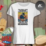 Dragon you don't stop reading when you get old you get old when you stop reading vintage s Ladies t-shirt
